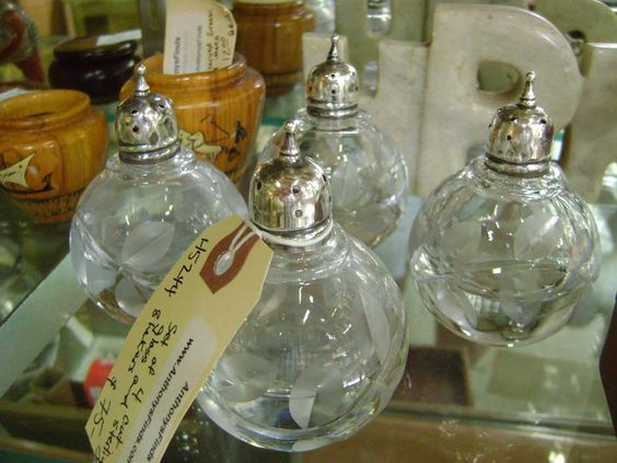 Great grouping of 4 heavy cut glass shakers with sterling tops!  These are also at Ventura Antique Market.....AnthonysFinds