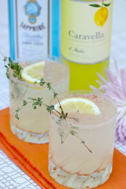 Limoncello Gin Cocktail: Limoncello, gin, lime juice and fresh thyme: