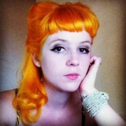 Orange gold hair with 1940's vintage inspired styling.