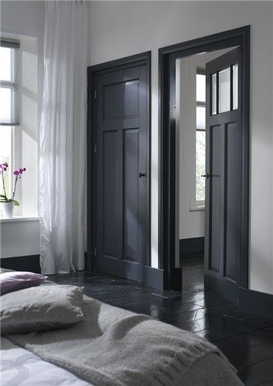 Paint walls white, doors charcoal and floors black.