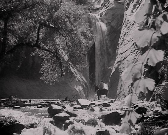 Filmmakers have preferred the sacred Indian Canyons since the advent of the movies. Frank Capra's Lost Horizon won two Academy Awards (Best Art Direction and Best Film Editing) by transporting moviegoers to a Utopian civilization high atop the mountains of Tibet. The famous sequence where Ronald Colman rides horseback and gazes at Jane Wyatt swimming under a 60-foot waterfall was filmed in Tahquitz Canyon.: