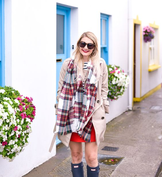 Jenna Colgrove wearing a plaid scarf, red mini skirt, and striped shirt in the Ring of Kerry, Ireland.