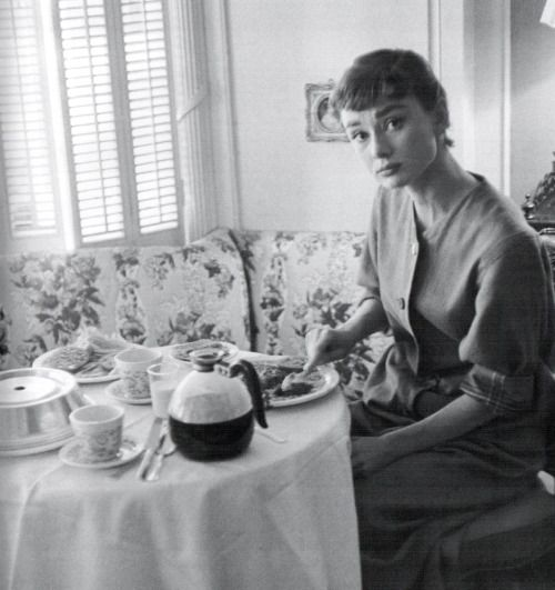 Audrey Hepburn in her apartment during the filming of Sabrina, 1953.