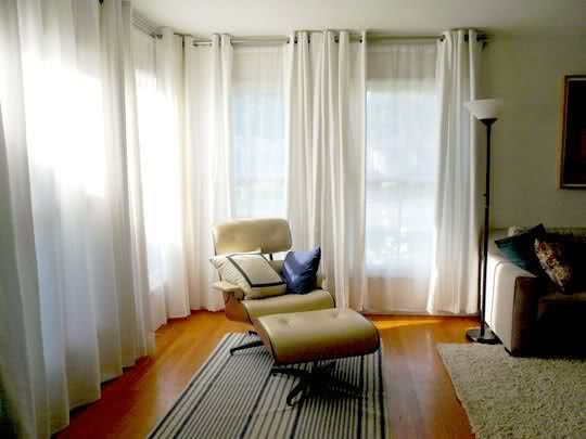 Double white curtains in living room. Front curtains have grommet ...