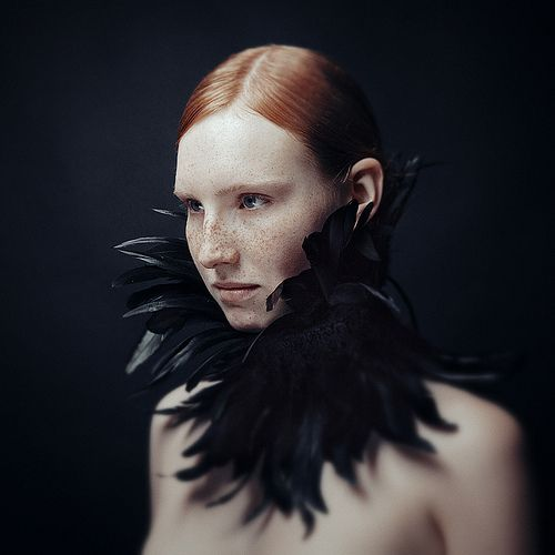 Raven inspired collar. Love that red hair against the black.