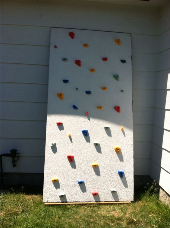 "DIY climbing wall My hubby did this for our kids in the backyard. I bought the rock wall grips on eBay and the the ply bored is 3/4"" that is 4 foot by 8 foot, we purchased from Lowes. We painted it with Restore (for decks) and screwed it into our home. Also when we installed the hand grips we cocked the holes with silicone to keep the wood from rotting out. A pretty simple project that my kiddos and our neighbor kiddos are loving!"