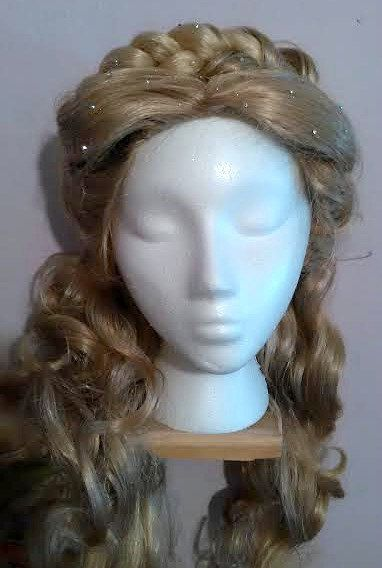 This wig is Inspired by the upcoming movie, CINDERELLA. It is a soft golden,ash blonde that falls below the shoulders in curls. It is dusted