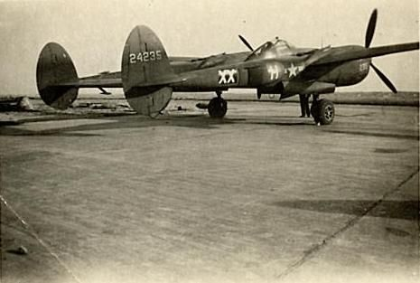 """Lockheed P-38 Lightning F-5E-4-LO (s/n 44-24235) 34th Photo Reconnaissance Squadron, 1945. Manufactured in 1944, this reconnaissance Lightning was Lt John Sanders' second plane. It's name, """"Sandy's Bandwagon"""", was painted on the nose. This photo would have probably been taken in Spring 1945, in Haguenau (France). This aircraft was scrapped in November 1945, and condemned on May 2nd, 1946."""