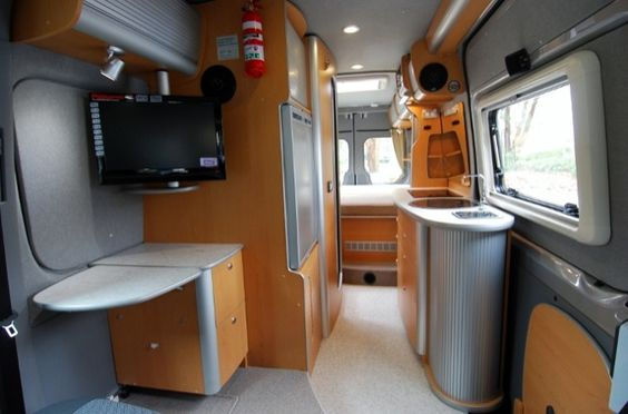 Interior Of A Trakka Jabiru 4x4 Sprinter Campervan Showing Aluminum Tambour Doors And Cabinetry