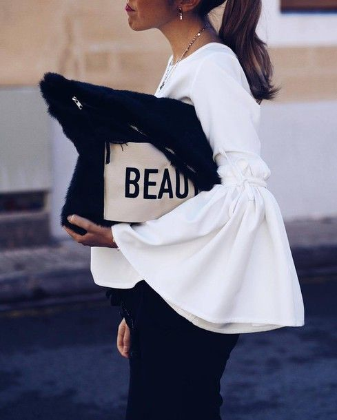 Top: tumblr white bell sleeves pants black pants bag black bag quote on it necklace jewels jewelry