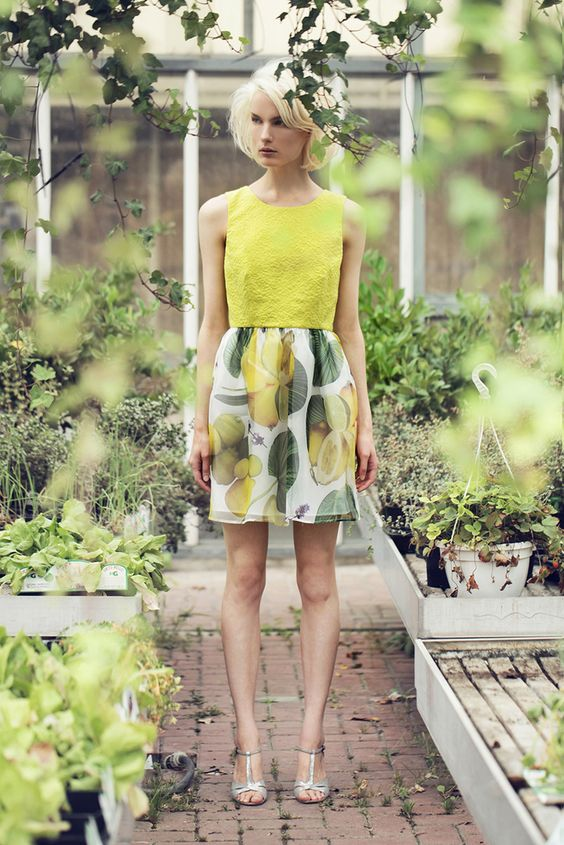 """A sleeveless lemon-yellow jacquard mini dress with rounded neckline, zip fastening and cut on the back, lemon-printed silk organza skirt.My tip: combine it with the lemon-printed oversized sweatshirt for a """"juicy"""" total look.Measures 38 size-waist 33 cm-lenght skirt 48 cm"""