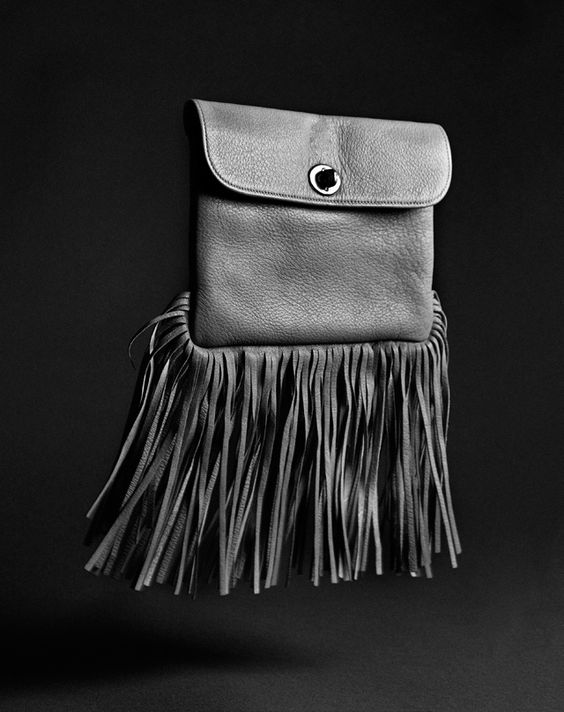 From the Coach archives: turnlock meets fringe on Bonnie Cashin's Krazy Klutch, circa 1965.