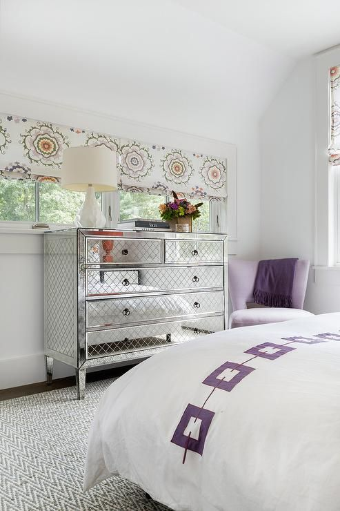 Purple Velvet Corner Chair Next To A Mirrored Dresser Facing A Bed With A Purple Chain Link Accent Embroide Furniture Dresser With Mirror Modern Bedroom Design