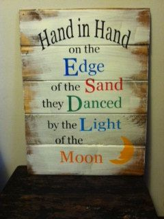 Sign: Hand in hand on the edge of the sand. $22.00, via Etsy.