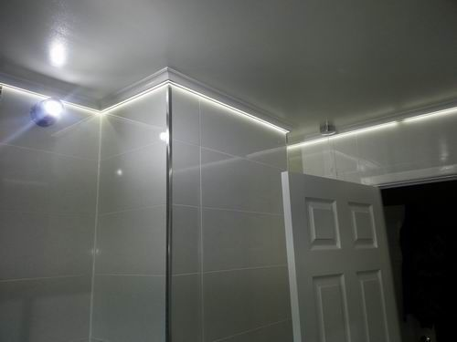Led tape is concealed behind coving in this bathroom for Coving for bathroom ceilings