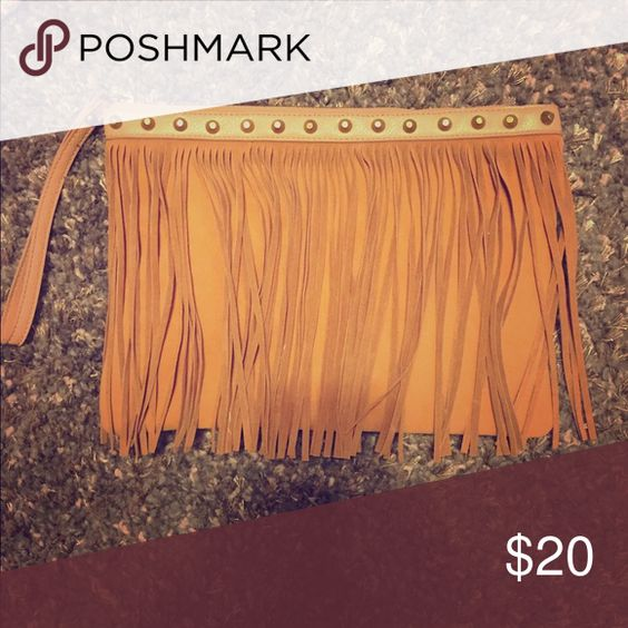 Cute fringe clutch Fringe clutch. Carried once. Bought from a local boutique. Bags Clutches & Wristlets