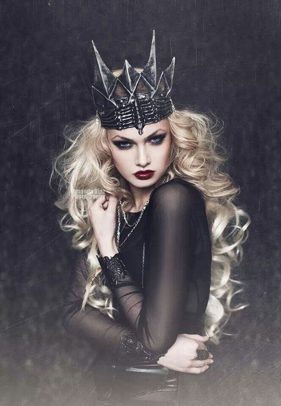We love this Dark Queen look - Wear a dark shade of red lipstick and create a dramatic smoky eye. Create a high brow arc using an eyebrow pencil - Style It With: A black dress, piles of silver jewelry, and of course a crown - please click for 9 other make up looks perfect for any Halloween party...x