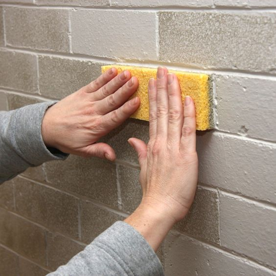 Fireplace makeover using sponges to repaint bricks, thought this may be a good way to fix the bricks downstairs.
