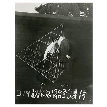 Alexander Graham Bell kissing his wife Mabel while she holds a tetrahedral kite,  1903. (National Geographic)