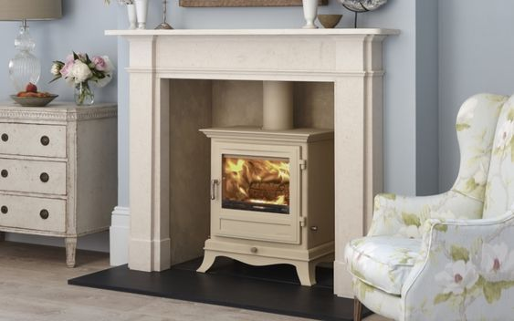 The Beaumont 6KW stove has swept cabriole legs and a corniced top section. It will set you back £1,375 (excluding vat). It sits in the Devonshire fireplace. Both from Chesneys (chesneys.co.uk)