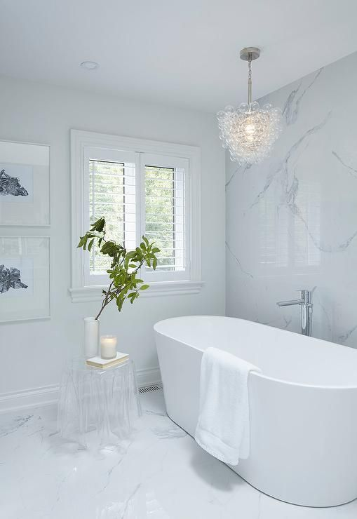 A Glass Bubbles Chandelier Hangs Over A Modern Oval Bathtub Paired