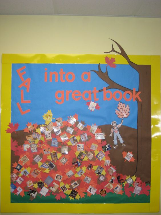 """""""Fall into a great book"""". I cut apart a poster with all the award winning books to create my book-leaf pile. One of my students created the boy who is falling, since I can't draw."""