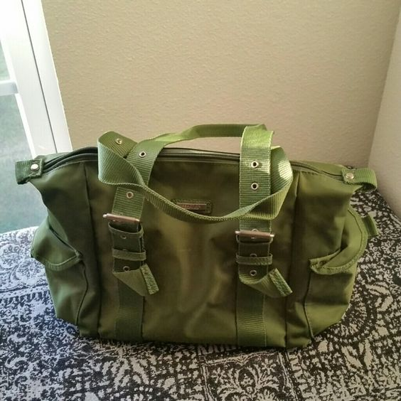 KENNETH COLE REACTION.. CUTE GREEN ...PURSE GREAT CONDITION. .NEW LISTING...CUTE SMALL/MEDIUM SIZE PURSE PERFECT FOR TEENAGER.......color army green. ..has side pockets is in great condition. ..pre.. loved...has chrome silver studs ...3 pic shows you could see has no stains. .it's .measurement is 15th/9.....$10..FINAL PRICE  ..NO OFFERS.... Kenneth Cole Reaction Bags