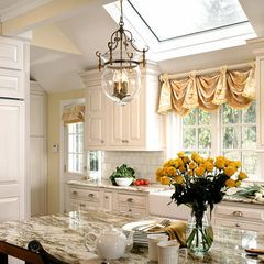 great window treatment over the sink traditional kitchen by J. Stephens Interiors