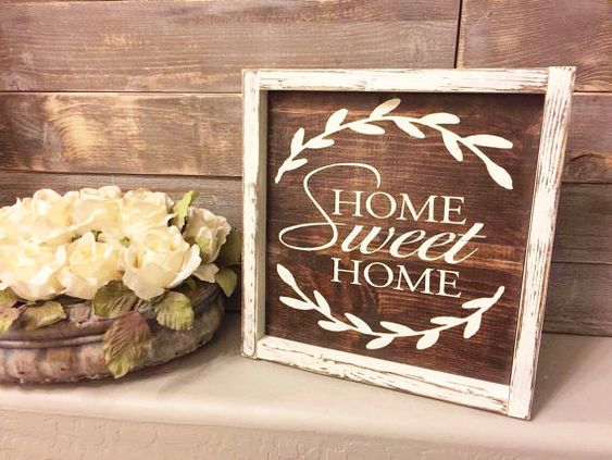 This rustic Home Sweet Home sign is approx. 11X11 its made out of stained wood and paint. It is slightly distressed and will compliment almost any decor. Since this is real wood the grain/knots and hue of wood will vary slightly for each order. Each sign will be unique yet beautiful. --------------------------------------------------------------  Hangers are attached so you can immediately hang your sign, or you can stand it on its side.