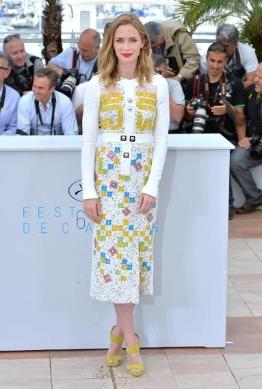 Emily Blunt amps up white eyelet with pink, green, yellow, and blue embellishments, as well as a bright orange statement lip.