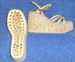http://shoedo.com/shoecomponents.html    Platform soles for hobby shoe makers