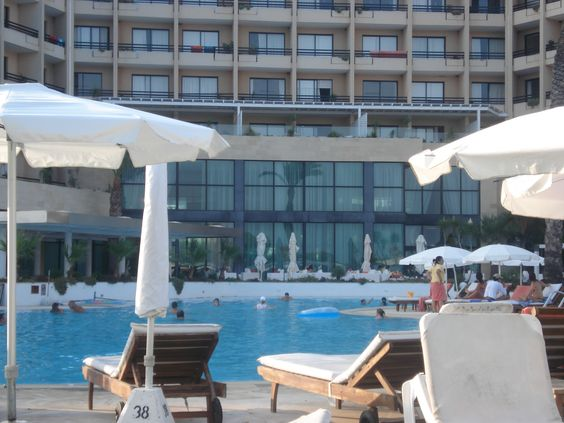Sunbathing poolside at 5 star Gecian Park Hotel in Protaras, Cyprus