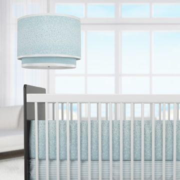 This beautiful set of crib bedding by Oilo Studio has a subtle raindrop effect in oh-so-pretty aqua blue. #nursery