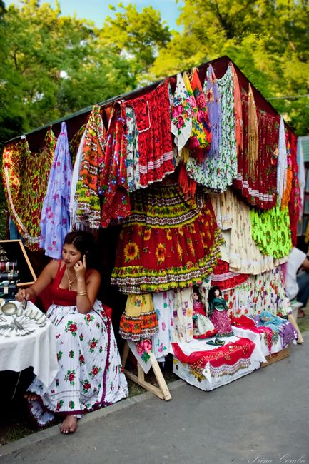 Gypsy: A #Gypsy woman selling traditional Gypsy clothing in a Romanian market.: