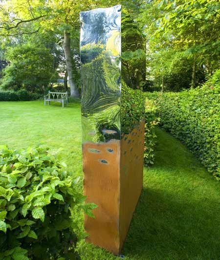Outdoor sculpture, polished chrome and rust effect: