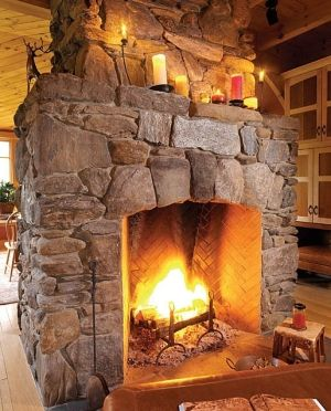 Rustic fireplace - fabulous stacked rock fireplace with a large opening by…