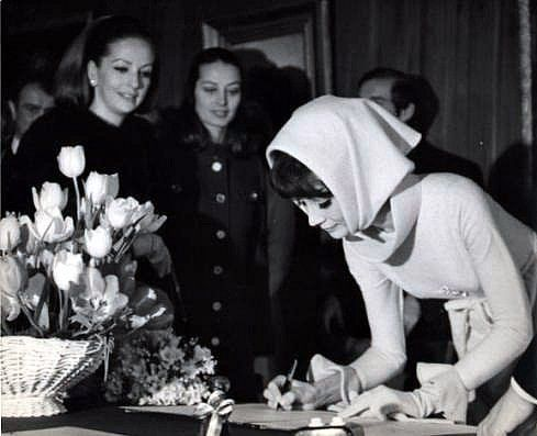 Audrey Hepburn in an ensemble by Givenchy, signing the register at her wedding to Dr. Andrea Dotti. Witnessed by dear friends Doris Brynner and Capucine, at Morges, Switzerland, January 18th, 1969.