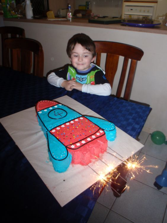 A rocket cake, with sparklers for the rocket to 'blast off'. Wonder if sparklers inside a fireworks building would be a bad idea? Ha ha