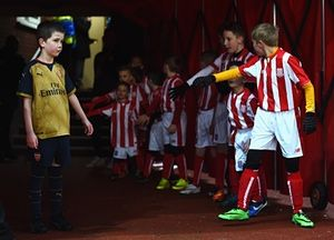 Arsenal and Stoke mascots wait for the players to arrive in the tunnel at the Britannia Stadium