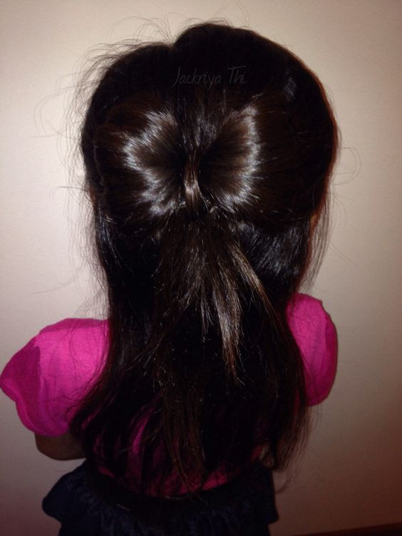 My daughter's half up do bow hair style.