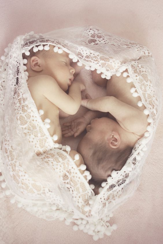 Twin baby girls...i love this picture and the lacy pom-pom blanket.: