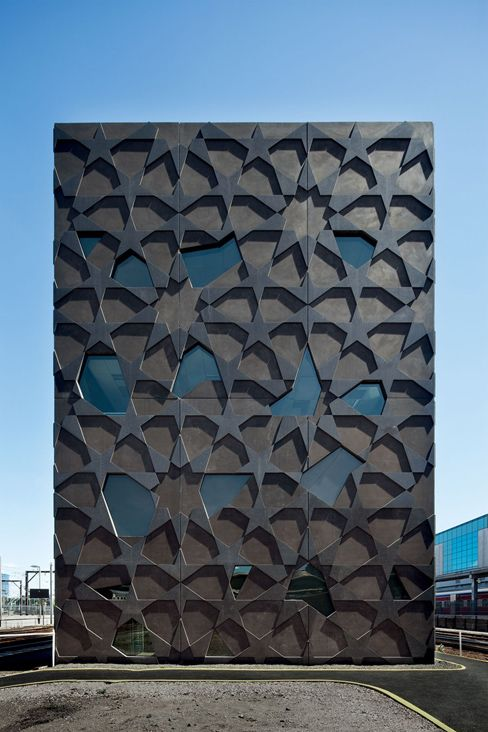 Mcbride Charles Ryan, The Yardmasters Building, Melbourne, 2009.  Moorish influences in building exterior, incorporating windows.