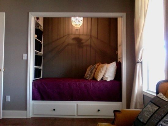 Bed in closet with shelves