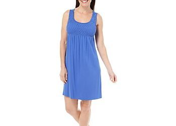 Spense offers effortless style in this sleeveless dress featuring chic tank styling, a solid design throughout