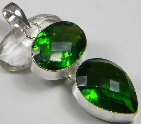 Gemstone : Faceted Chrome Diopside,,Length : 2.5 Inches including Bail,,Width : 0.75 Inches,,Total Weight : 18 Gms