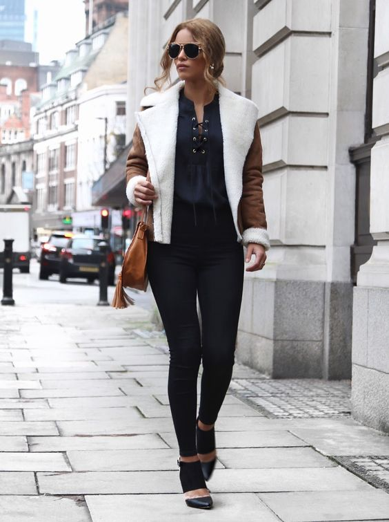 Nada Adellewears the lace up trend on a gorgeous... - Street Style