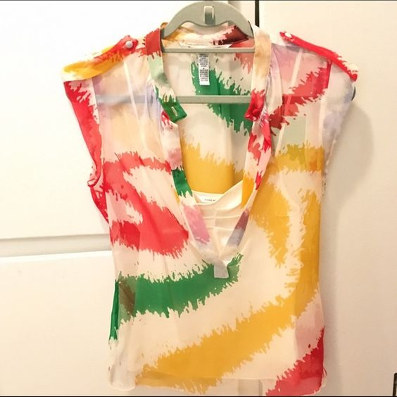 DVF Sheer Top with Attached Camisole DVF sheer top with attached silky camisole. Can be buttoned at the neck or left open. Additional sheer fabric pieces at the shoulders are accents. Very bright colors, and the shirt is in good condition! Diane von Furstenberg Tops Blouses
