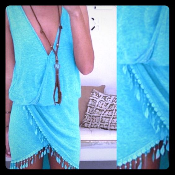 Sexy Plunging Neck Sleeveless Dress Trendy asymmetrical hemline with tassel trimming. New, never worn, perfect condition. No trades.  Would be a great swim suit cover up! Not BB brand. Beach Bunny Dresses Asymmetrical