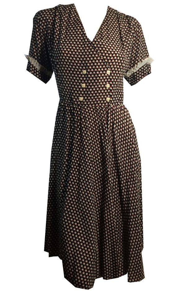 "1930s deep blue rayon dress with white and red tulip print, side metal zipper. No flaws. Measures 40"" bust, 32"" waist, 15"" bodice, 62"" hips, 40"" long, 8"" sleeves"