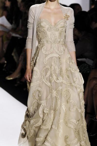 cardigan over a gown as seen at Oscar de la Renta